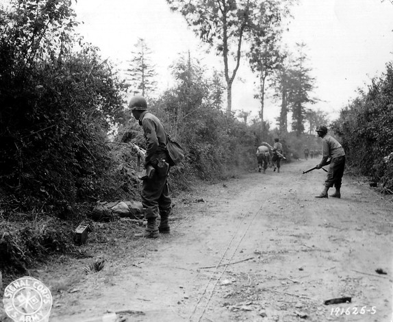 U_S_Army_in_World_War_II_Photograph_of_GIs_Moving_Cautiously_Between_Hedgerows_in_Normandy